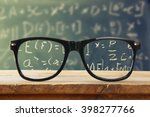 hipster glasses on a wooden... | Shutterstock . vector #398277766