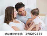 happy couple playing with baby... | Shutterstock . vector #398292556