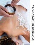 woman enjoying a salt scrub... | Shutterstock . vector #398299762
