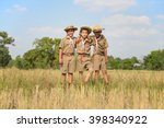 three scouts stand neck of the... | Shutterstock . vector #398340922