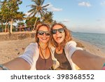 two happy girlfriends making... | Shutterstock . vector #398368552