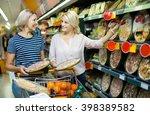 adult girl helping senior... | Shutterstock . vector #398389582