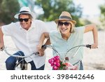 portrait smiling couple ridding ... | Shutterstock . vector #398442646