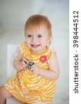 adorable smiling baby girl | Shutterstock . vector #398444512