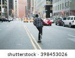 back of young skateboarder... | Shutterstock . vector #398453026