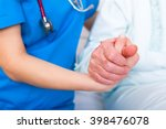 nurse helping up senior woman ... | Shutterstock . vector #398476078