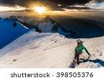 girl climbing the mountain in... | Shutterstock . vector #398505376