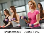 group of people exercising at... | Shutterstock . vector #398517142