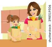 cute daughter helps her mother... | Shutterstock .eps vector #398519506