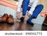 man who put his socks with... | Shutterstock . vector #398541772