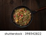 delicious asian rice on a black ... | Shutterstock . vector #398542822