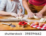 father and daughter making dough | Shutterstock . vector #398594662