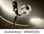 Athlete Kicking Soccer Ball In...