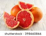 Juicy Grapefruits On Wooden...