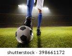athlete kicking soccer ball | Shutterstock . vector #398661172