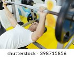 handsome man lifting weights in ... | Shutterstock . vector #398715856
