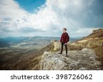 man on top of mountain.... | Shutterstock . vector #398726062