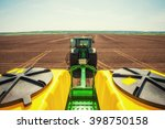 Tractor plowing farm field in...