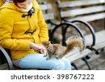 Young Beautiful Woman Feeding ...