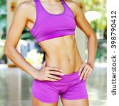 Small photo of Close up abdominal muscles of young female athlete woman