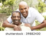 senior man hugging adult son | Shutterstock . vector #39882430