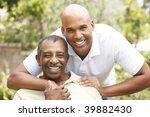 senior man hugging adult son | Shutterstock . vector #39882430