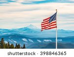 American Flag Over The Peak Of...
