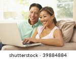young couple using laptop at...   Shutterstock . vector #39884884