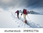 two elderly alpine skiers climb ... | Shutterstock . vector #398902756