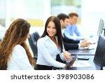two smiling businesswomen... | Shutterstock . vector #398903086