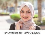 smiling girl in hijab covering... | Shutterstock . vector #399012208