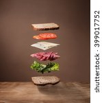 Small photo of Floating Sandwich on wood table