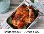 whole roast chicken on grey... | Shutterstock . vector #399065122