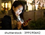 Woman Use Mobile Phone In City...