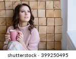 pretty young woman in the pink... | Shutterstock . vector #399250495