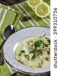 Small photo of Fricassee of chicken in a plate on wooden table.