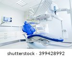 dentistry, medicine, medical equipment and stomatology concept - interior of new modern dental clinic office with chair - stock photo