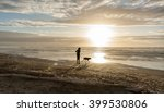 silhouette woman and dog on... | Shutterstock . vector #399530806