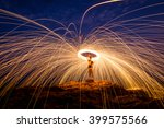 fire dancing on the rocks | Shutterstock . vector #399575566