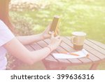 hand touch phone on a wooden... | Shutterstock . vector #399636316