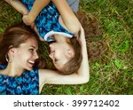 mother and daughter hugging in... | Shutterstock . vector #399712402