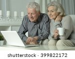 happy senior couple with laptop | Shutterstock . vector #399822172