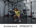 girl doing squats at the gym | Shutterstock . vector #399826972
