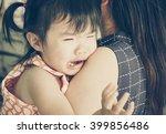 asian baby girl hugging her... | Shutterstock . vector #399856486