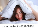 female lying on bed and closing ... | Shutterstock . vector #399860155