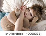 toddler sleeping with her hare | Shutterstock . vector #40000339