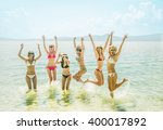 young group of people jumping... | Shutterstock . vector #400017892