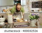 man cooking at home in kitchen  ... | Shutterstock . vector #400032526