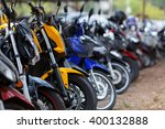 Motorcycles Parked In Row