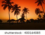 sunset on caribbean beach with... | Shutterstock . vector #400164085